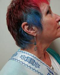 Lynn is our model for this style of earrings in our Messianic line.
